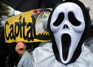 Occupy Global: A South Korean protester holds a banner during the Occupy Seoul rally