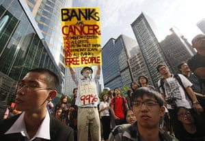Occupy Global: A protester at an Occupy Hong Kong rally outside the Exchange Square