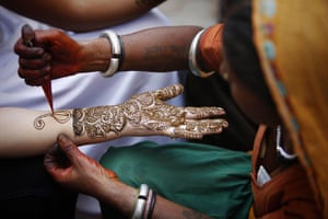 24 Hours: A Hindu woman has henna applied on her hands