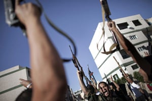 24 Hours: National Transitional Council fighters celebrate in Tripoli
