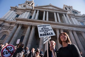 Occupy London: Protestors stand on the steps of St Paul's Cathedral during Occupy London