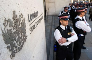 Occupy London: Police stand guard outside the London Stock Exchange during Occupy London