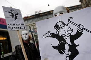 Global Occupy: A masked protester hold a banner in Zurich