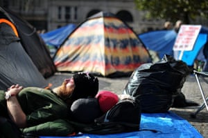 Occupy London protests: Oct 16: A protester sleeps among tents outside St Paul's Cathedral