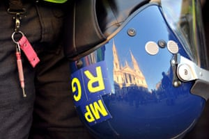 Occupy London protests: St Paul's Cathedral is reflected in a police officer's helmet