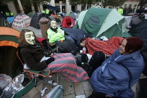Occupy London protests: Protesters sit outside their tents outside St Paul's Cathedral
