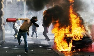 Rioters in Rome also planted a rudimentary bomb and used street furniture as weapons