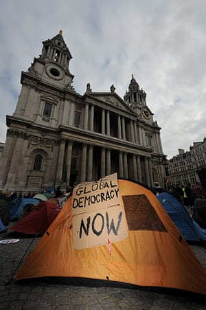 Occupy London Protests: A placard is seen on a protestors tent with St Paul's in the background