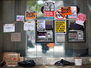 Occupy London Protests: Placards cover ATM machines