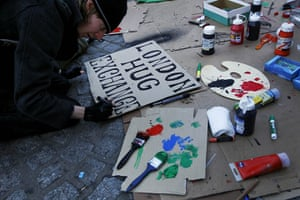 Occupy London: a protester puts the finishing touches to a placard