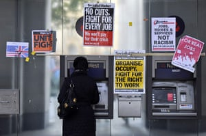 Occupy London: protest posters around a cash machine
