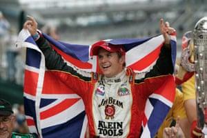 Dan Wheldon Retrospective: Dan Wheldon celebrates in the winner's circle after he won the Indy 500