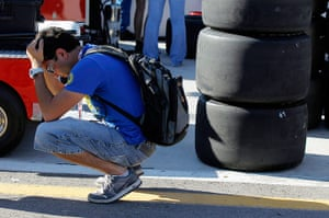 Dan Wheldon Retrospective: A person reacts along pit row to news of the death of Dan Wheldon