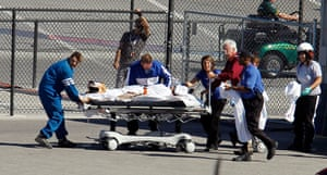 Dan Wheldon Retrospective: Dan Wheldon, of England, is transported to a helicopter following the crash