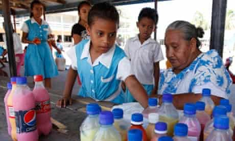 Students queue to buy drinks in recycled bottles at Nauti primary school in Funafuti, Tuvalu