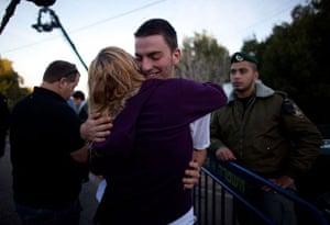 gilad shalit release: Israelis hug outside the house of Gilad Shalit in Mitzpe Hila, Israel
