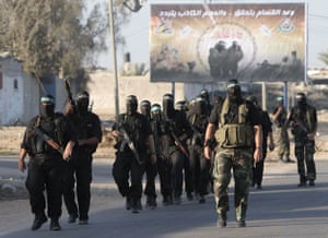 gilad shalit release: Hamas fighters patrol the border with Egypt at Rafah