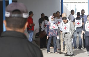 gilad shalit release: Members of the International Red Cross at the Rafah crossing with Egypt