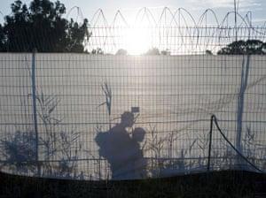 gilad shalit release: Israeli soldiers patrol behind a fence at Tel Nof air force base
