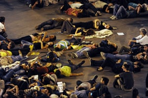 Occupy World Protests: Protesters lay on the street during at Puerta del Sol square in Madrid