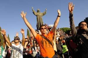 Occupy World Protests: Demonstrators hold hands up during an 'Occupy' protest in Rome, Italy