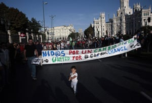 Occupy World Protests: A young demonstrator plays the flute during a march in Madrid