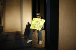 Occupy World Protests: A protester displays a placard Occupy Phoenix demonstration, Arizona