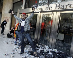 Occupy World Protests: Protesters throw garbage bags at Barcelona's stock exchange