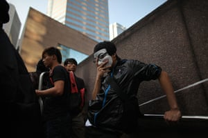 Occupy World Protests: An activist rests during a protest outside the Hong Kong stock exchange