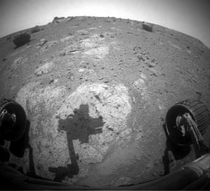 Month in space: robotic arm of NASA's Mars Exploration Rover Opportunity casts a shadow
