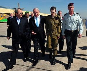 Shalit release: Gilad Shalit walks with Israeli Prime Minister Benjamin Netanyahu