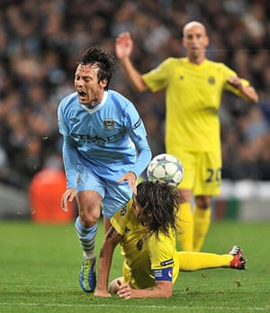 Tuesday Champions League: David Silva comes off second best in a challenge with Gonzalo Rodriguez