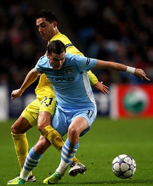Tuesday Champions League: Adam Johnson of Manchester City tangles with Villarreal's Bruno Soriano