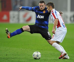 Tuesday Champions League: Sorin Frunza faces a lunging Wayne Rooney