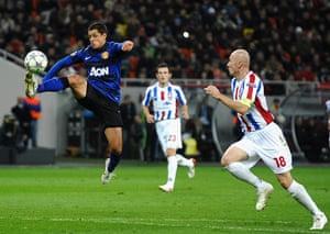 Tuesday Champions League: Javier Hernandez soars through the air as he controls a high ball