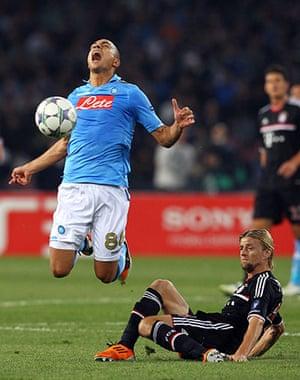 Tuesday Champions League: Goekhan Inler of Napoli is fouled by Bayern Munich's Anatoliy Tymoshchuk