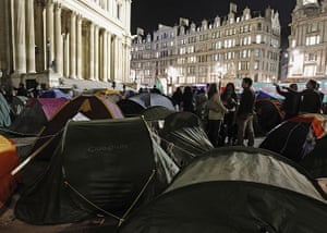 Occupy London protests: People stand among the tents of demonstrators outside St Paul's Cathedral