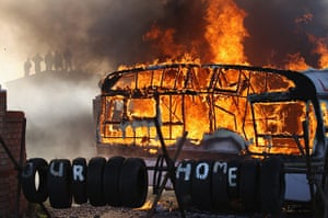 Dale Farm camp: Flames engulf a caravan during evictions from Dale Farm travellers camp
