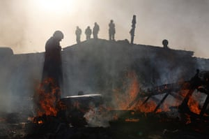 Dale Farm camp: A caravan is burnt down as activists stand nearby, Dale Farm