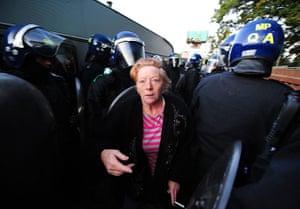 Dale Farm camp: A traveller walks through lines of riot police, Dale Farm