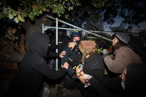 Dale Farm camp: Activists confront police as they enter the site at Dale Farm
