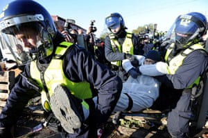 Dale Farm camp: A man is carried away by riot police, Dale Farm
