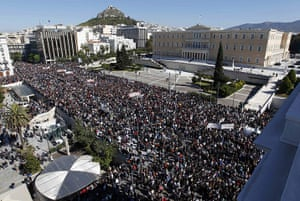Greece strikes & protests: People walk past the Greek parliament during an anti-austerity rally