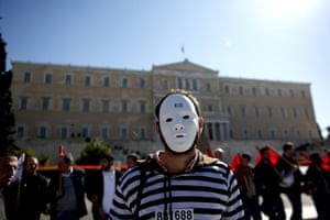 Greece strikes & protests: A demonstrator stands in front of the Greek parliament in Athens