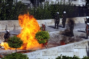 Greece strikes & protests: Protesters throw petrol bombs at riot police in front of Greek Parliament