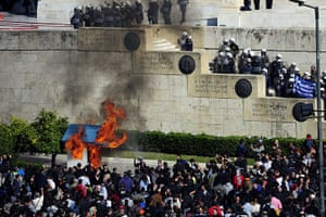 Greece strikes & protests: Protesters burn a guard box in front of the Greek parliament in Athens