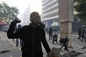 Greece strikes & protests: Protesters throw stones at Greek police officers during clashes in Athens
