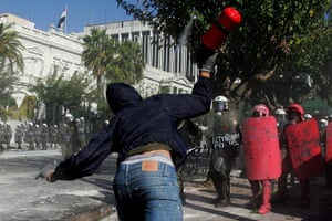 Greece strikes & protests: A demonstrator clashes with police