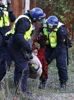 Dale Farm: A supporter is carried away by police during evictions