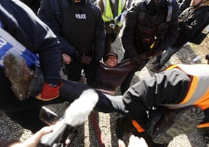 Dale Farm: An activist is removed by police and bailiffs during evictions
